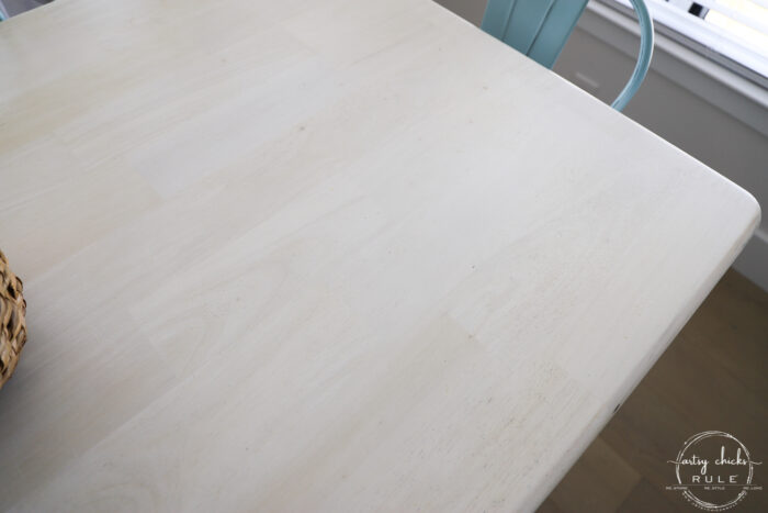 close of up whitewashed and bleached wood table grain
