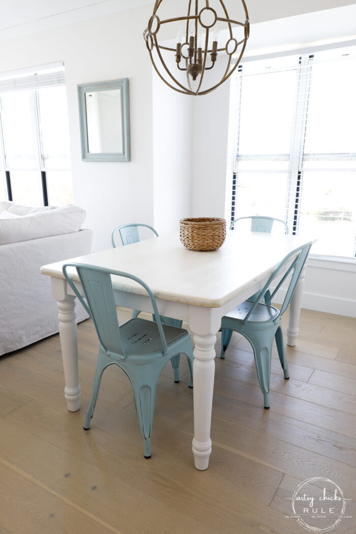 bleached wood top with white legs and blue metal chairs