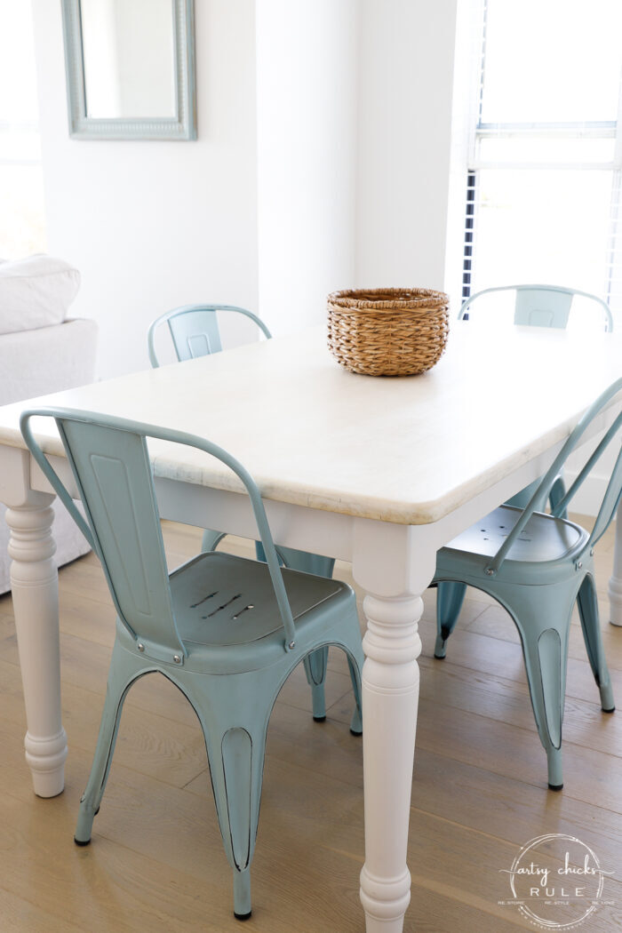 styled table view with basket on top and blue chairs
