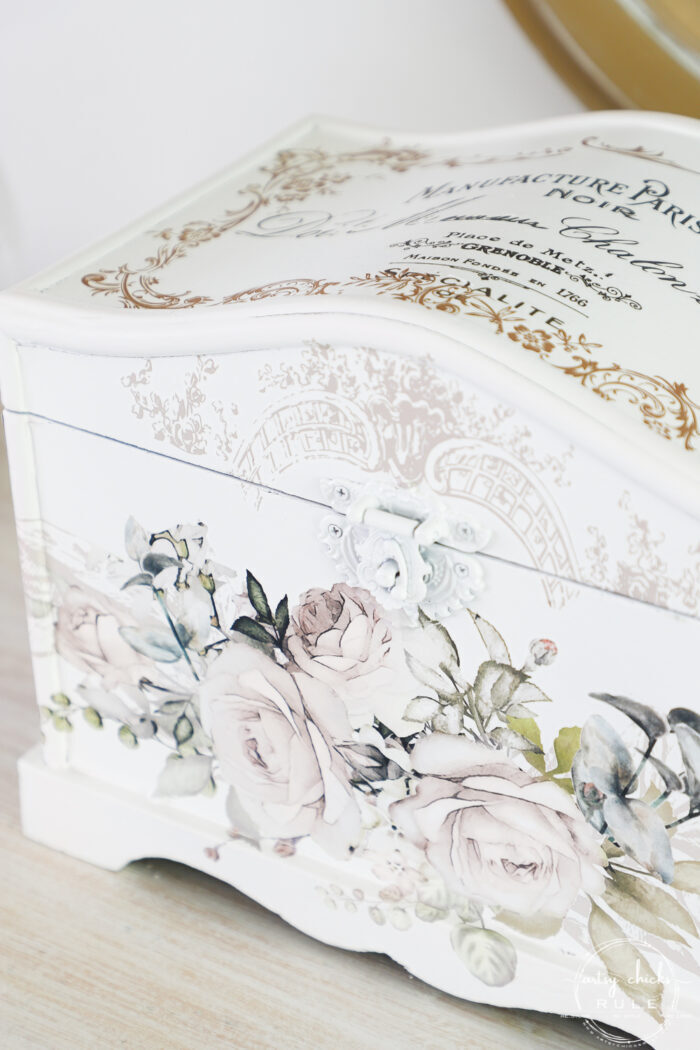 close up of front of white box with pretty floral transfer on front