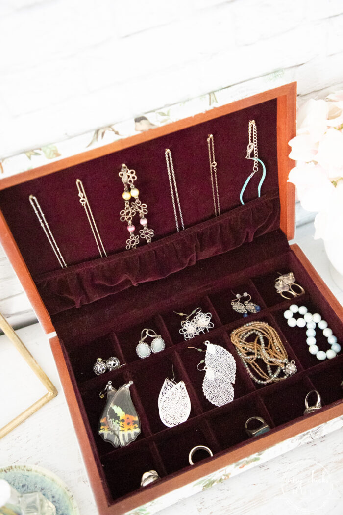 top view of open jewelry box with jewelry