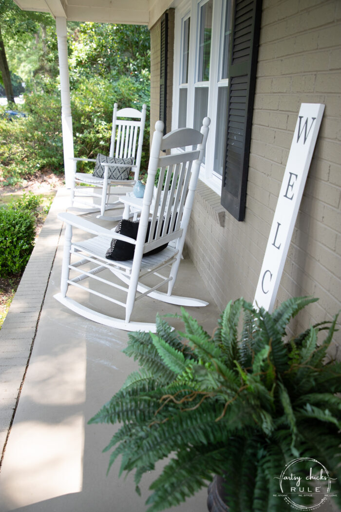 white rockers and green fern