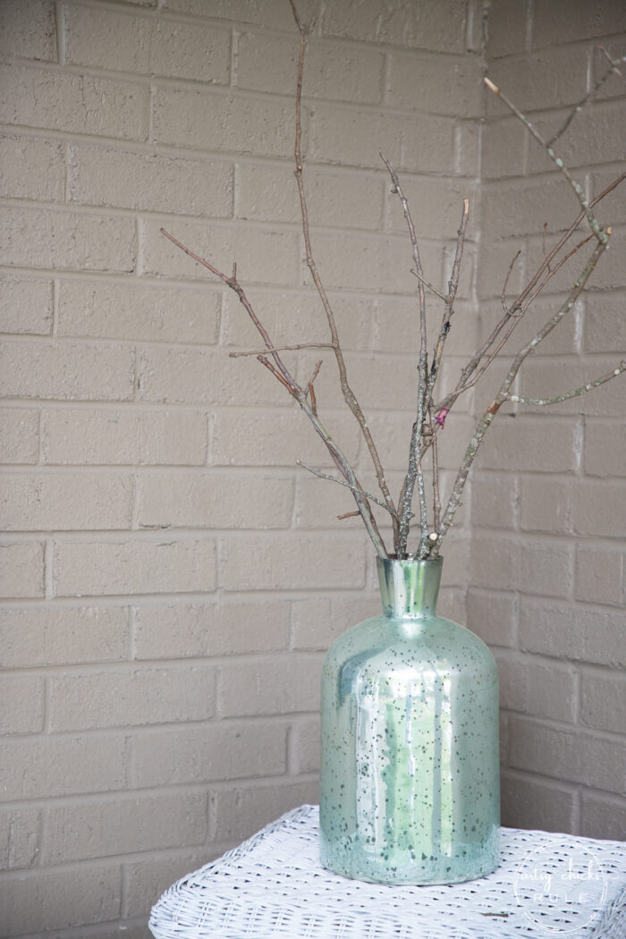 green vase with branches