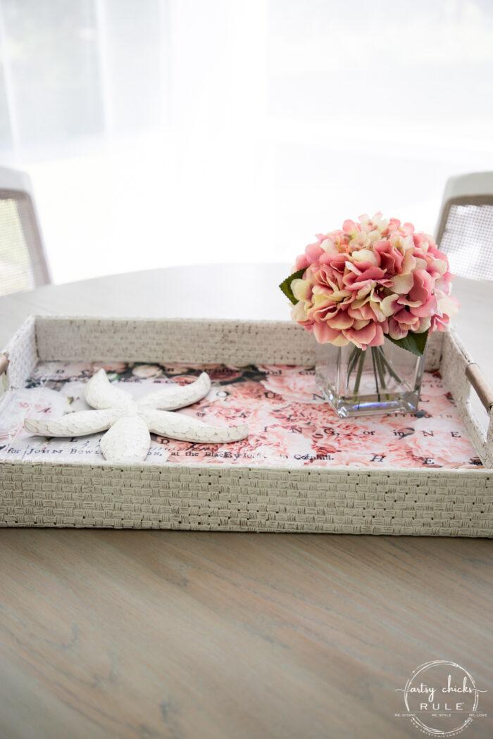 white basket pink tissue paper and pink flower arrangement