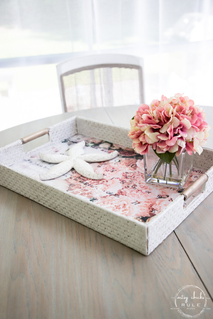 styled basket tray with pink flowers and starfish