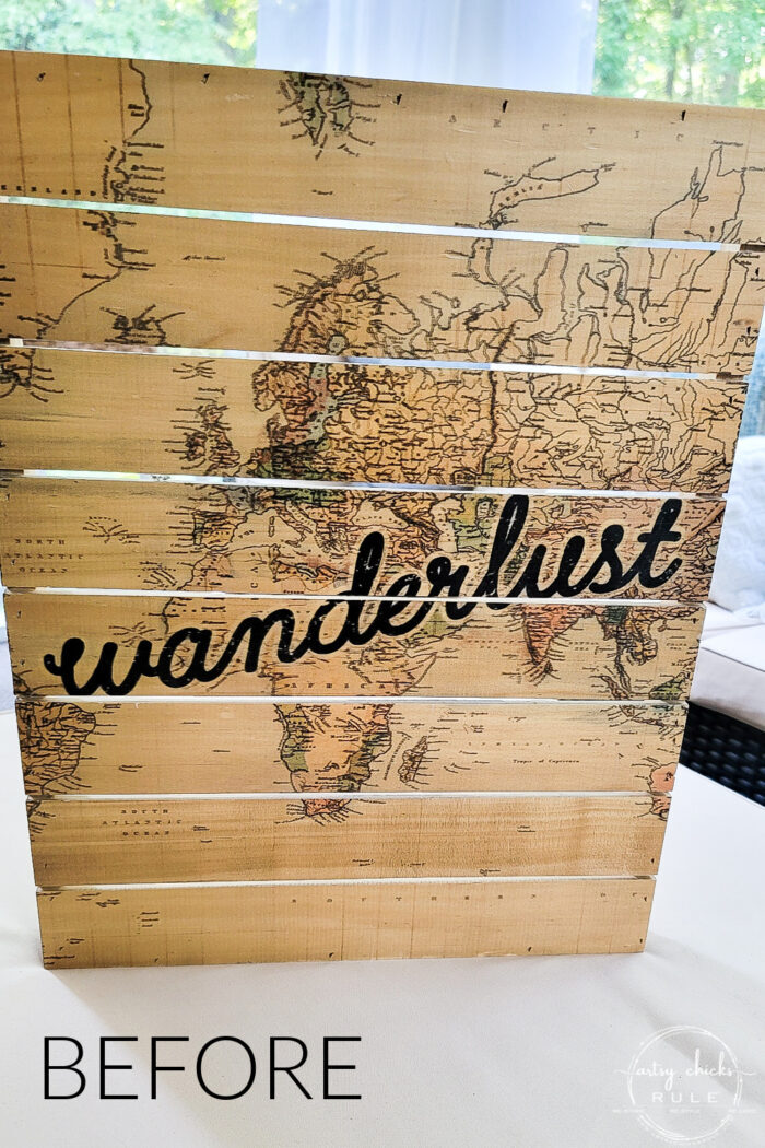 tan wood slatted sign with map