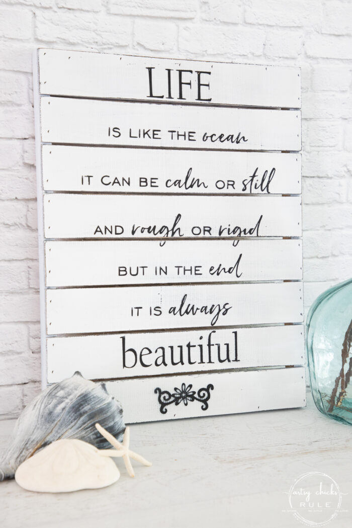 another view of life is like the ocean sign with seashells and aqua glass jar