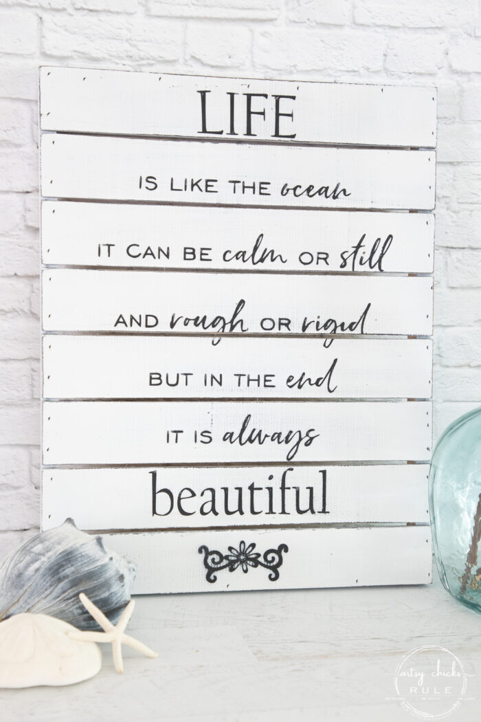 black and white sign with ocean quote