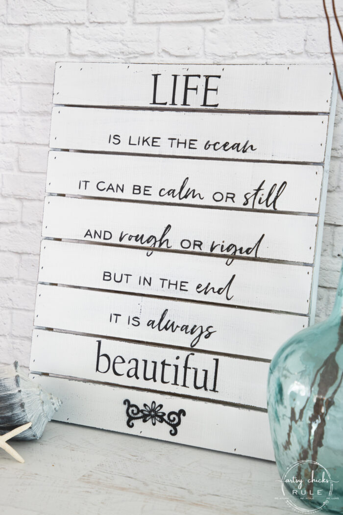 finished life is like the ocean sign on white brick wall