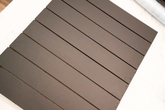 painted black slatted wood sign