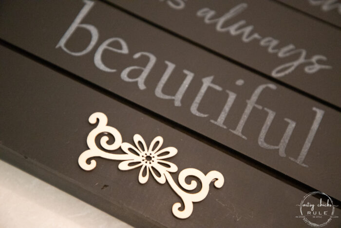 wood cutout decorative on black board