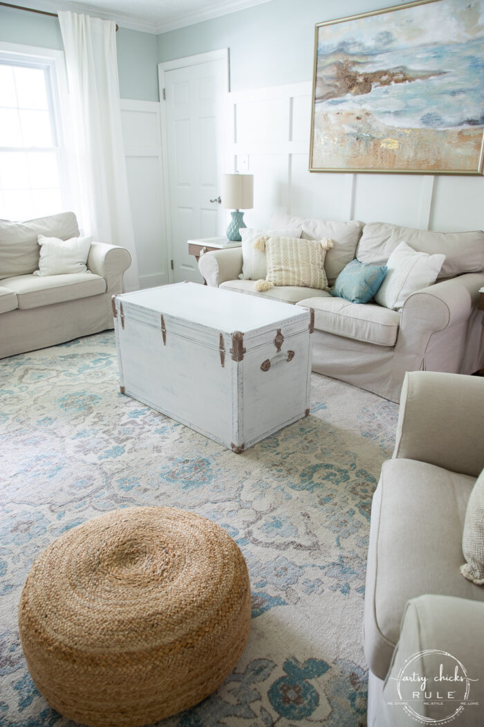 finished white trunk in aqua and neutral colored living room