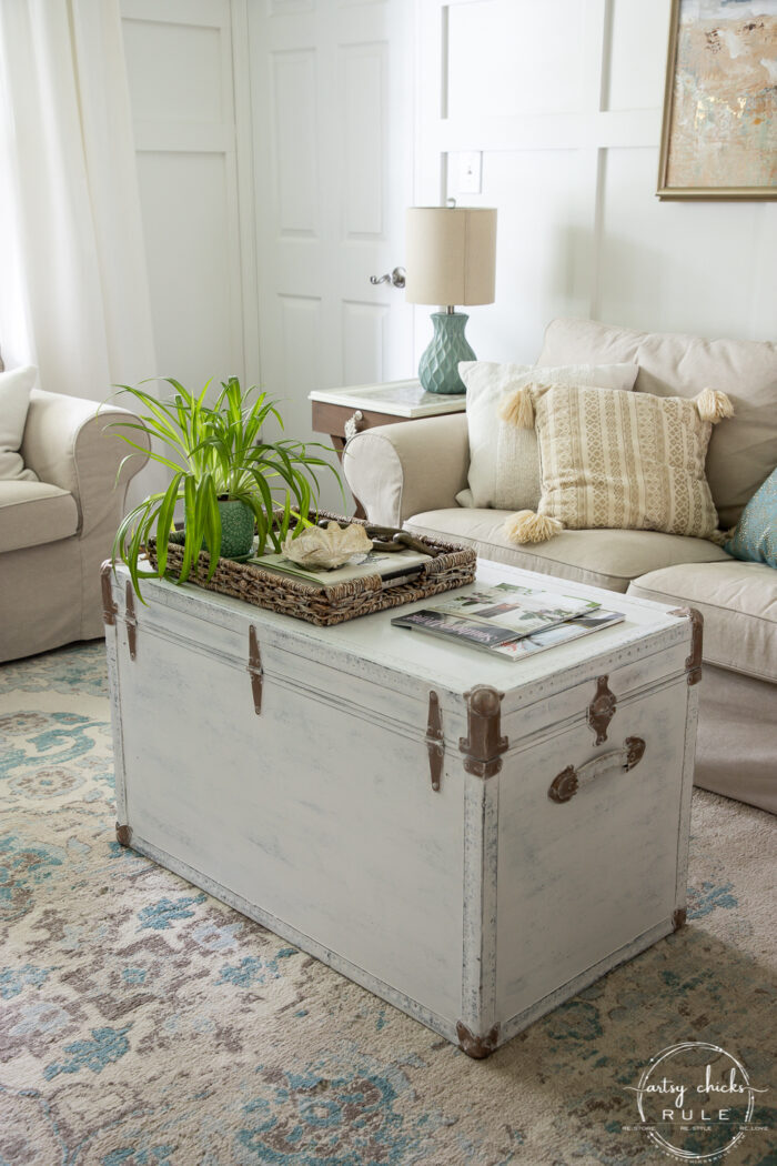 styled white trunk with couch