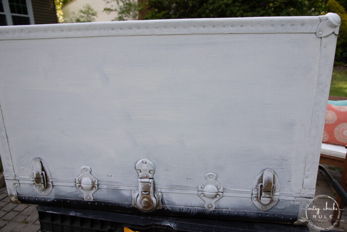 black trunk with white paint