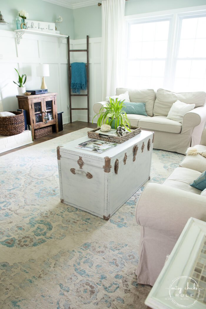 living room view with painted white trunk