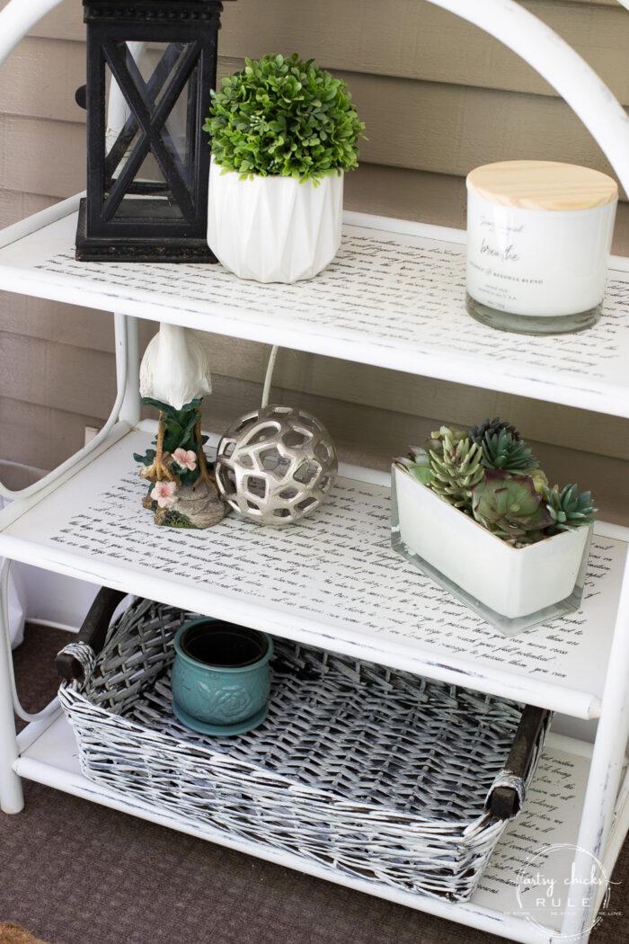 small floor shelf with various coastal decor items