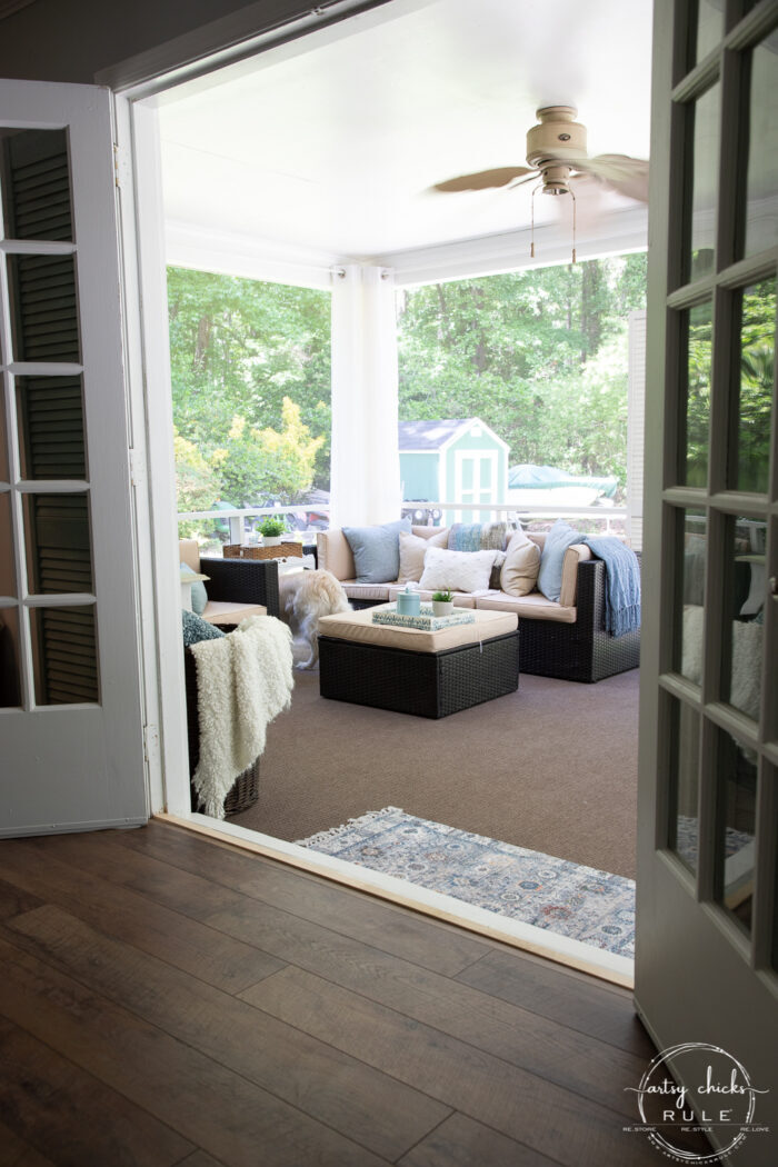 view from inside living space to out in screened porch through french doors