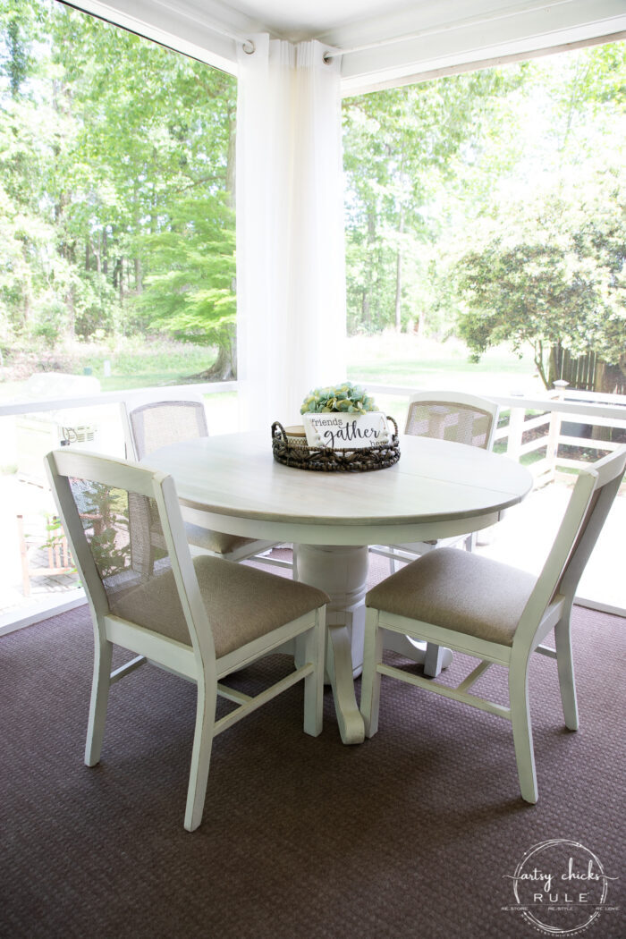 bleached wood tabletop with brown and white chairs