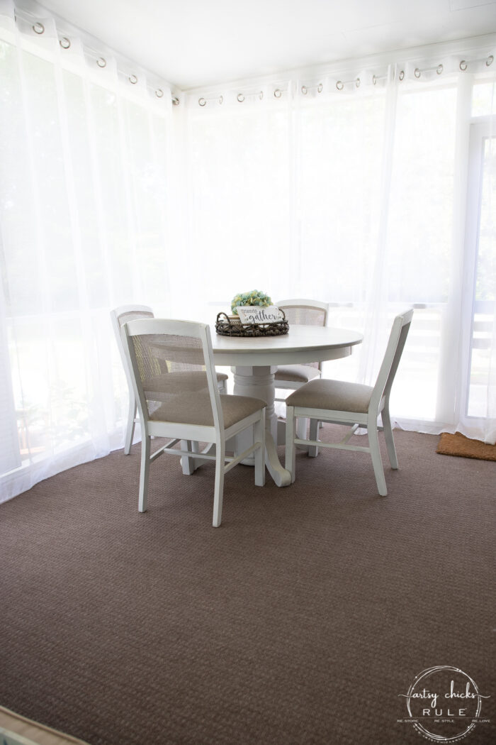dining table with sheer curtains pulled closed