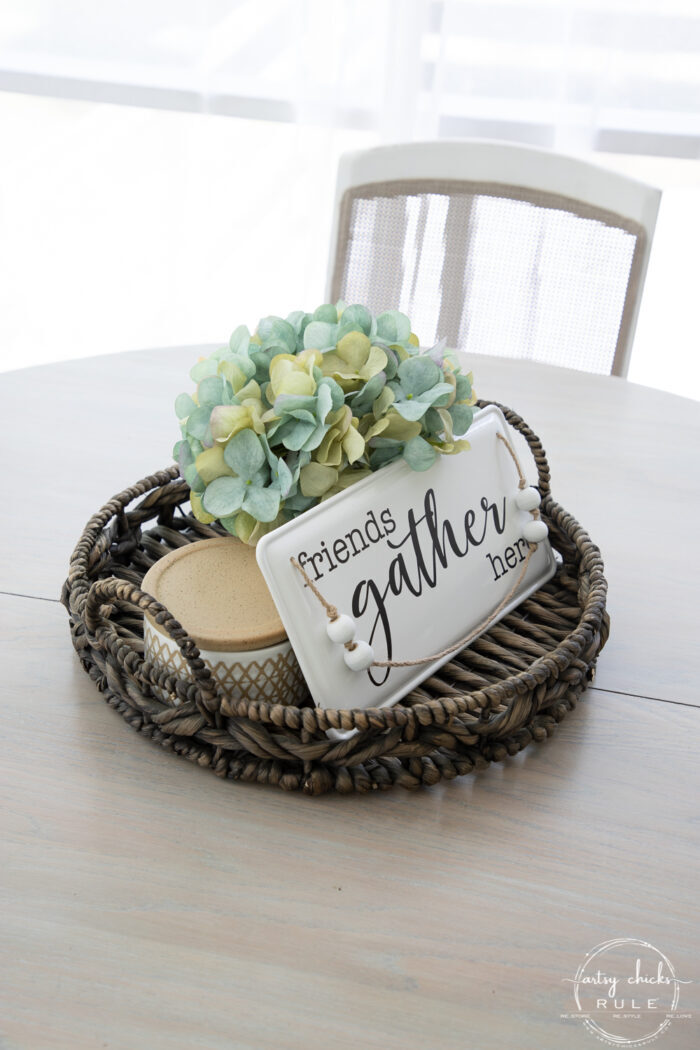 basket centerpiece with aqua hydrangea and white/black gather sign