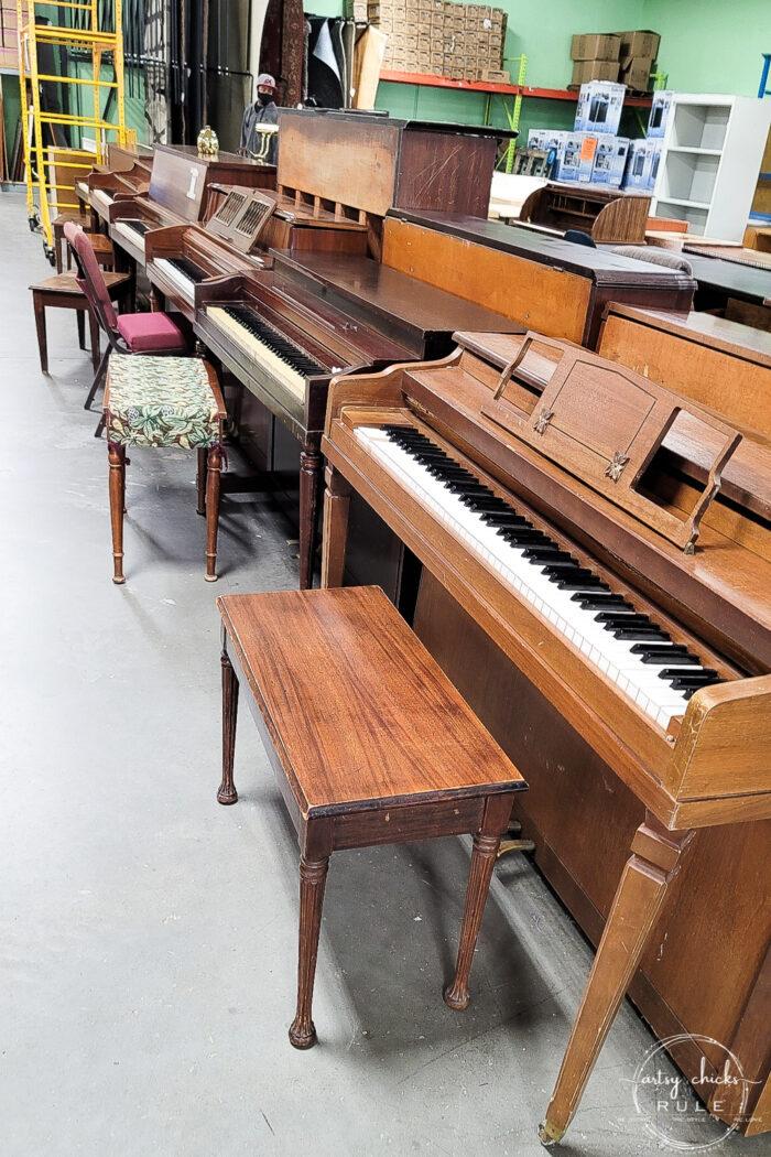 row of pianos