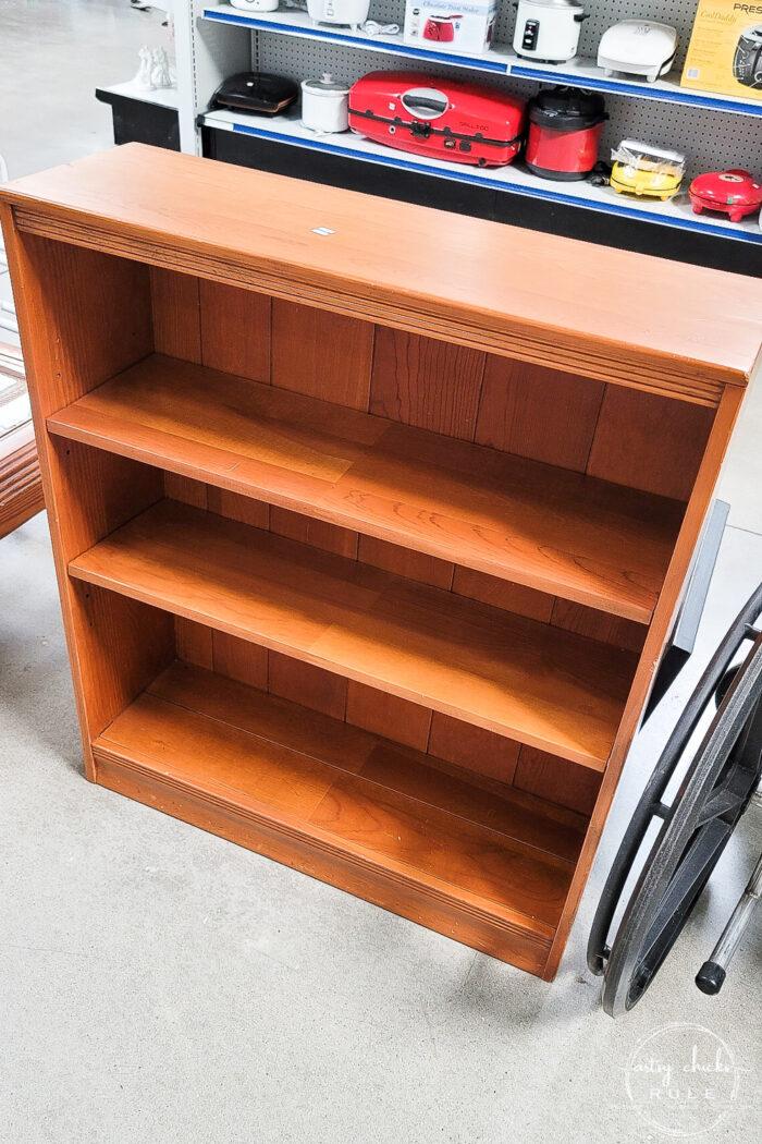 orangey solid wood shelf