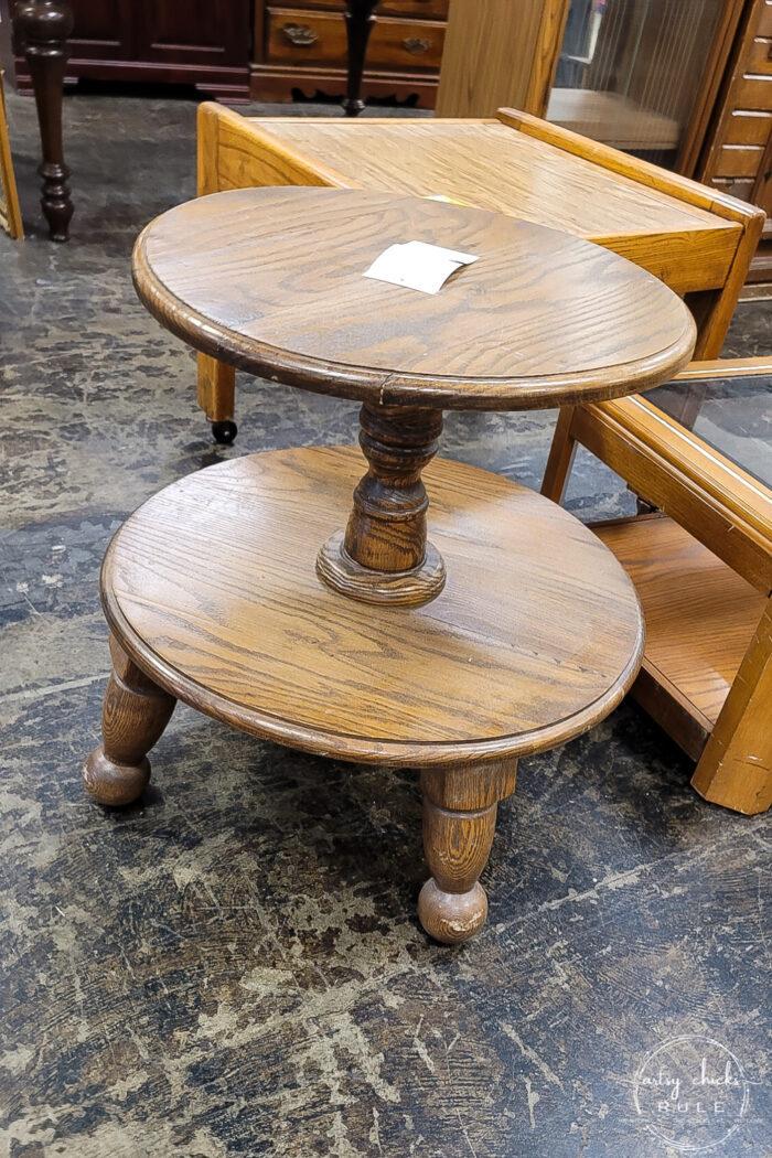 odd looking 2 shelf table round