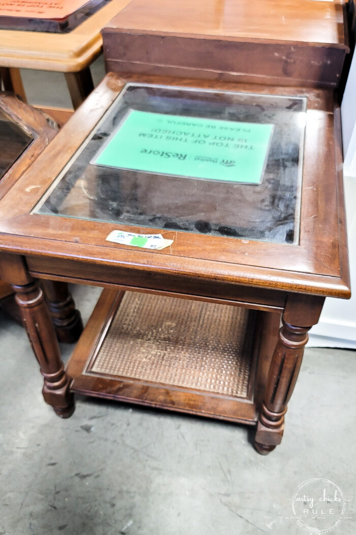 glass top wood end table with cane shelf