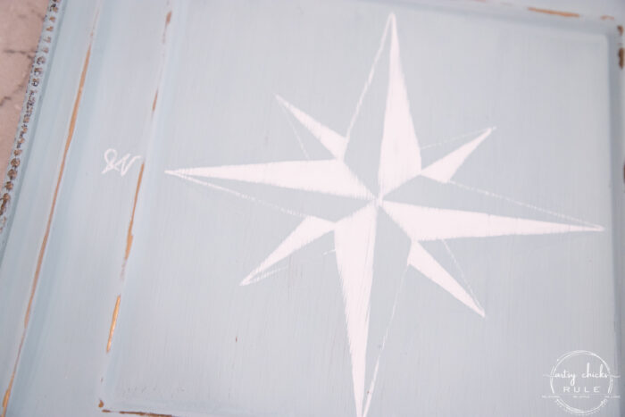 finished white compass rose on blue tray lightly sanded