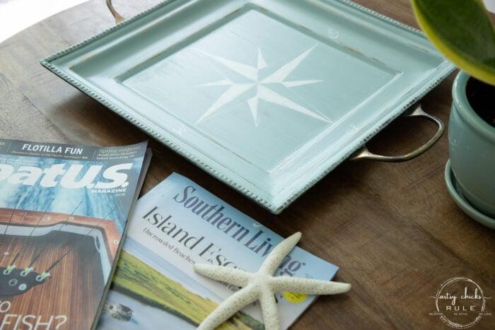 magazines on wood table with aqua tray