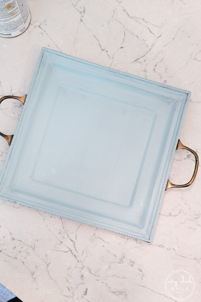 top view of blue tray with metal handles