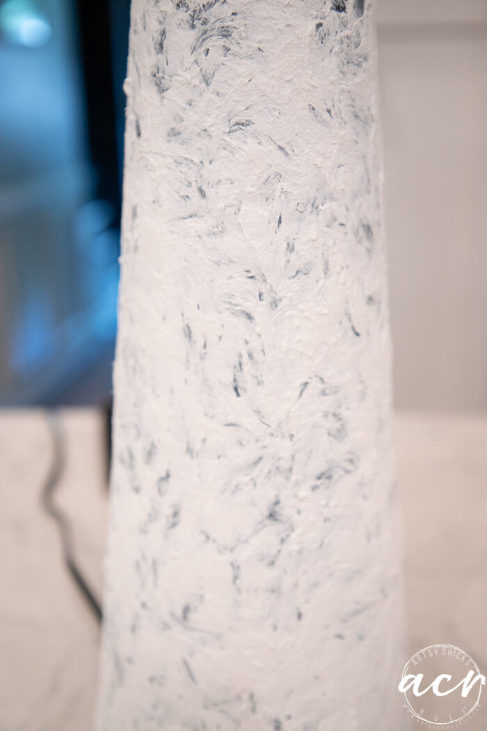 white fiber paste to add a faux stone look on lamp