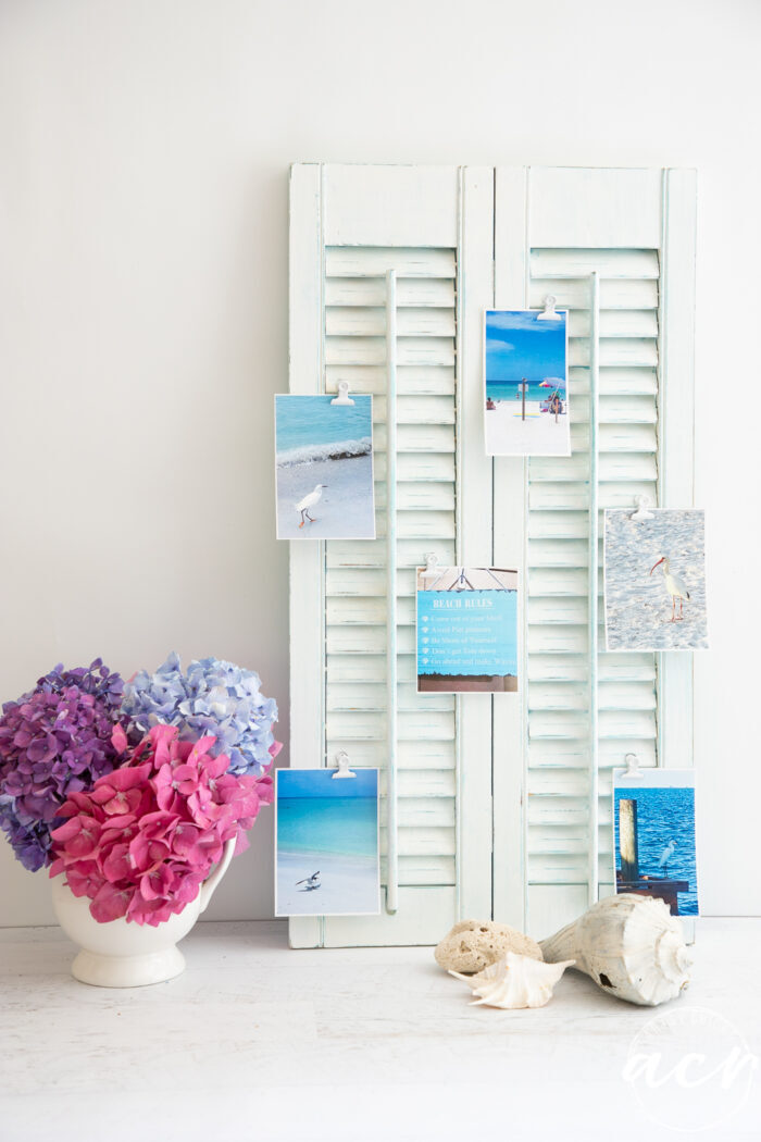 white shutter with beach photos clipped