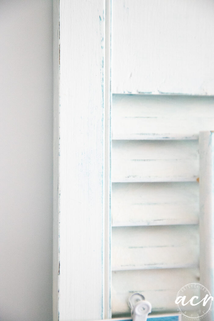 up close of white and blue shutters