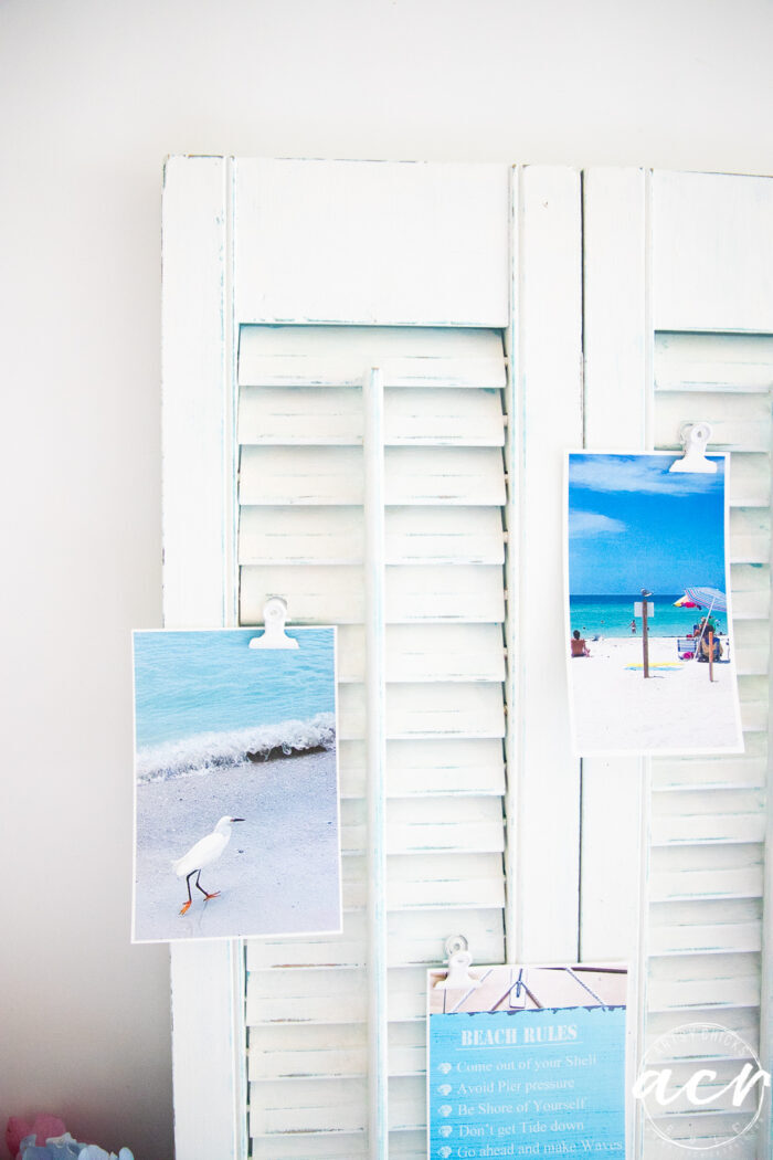 white shutters with blue water beach scene photos