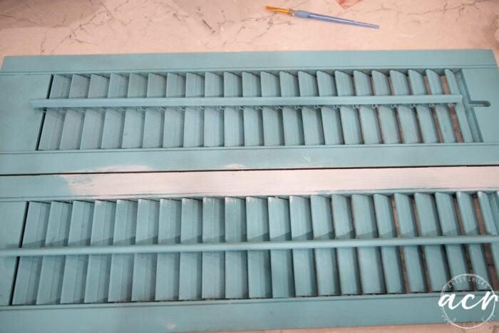 wood shutters painted aqua