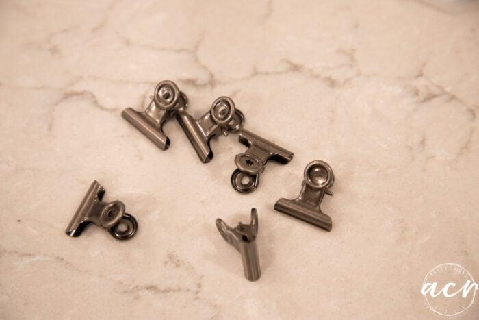 6 small bronze clips