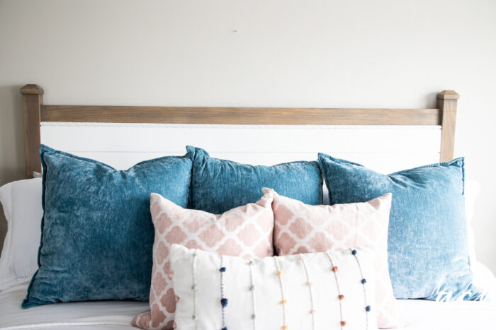 colorful pillows on white bed
