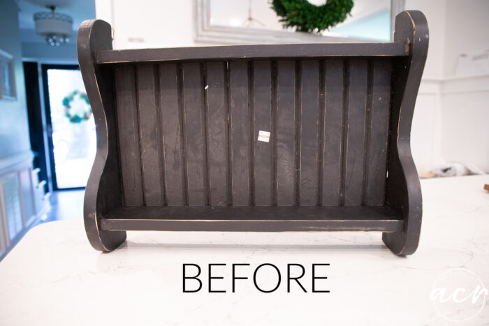 black slatted worn looking shelf
