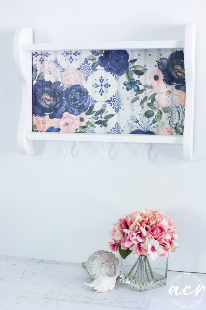 blue and pink floral white shelf on wall