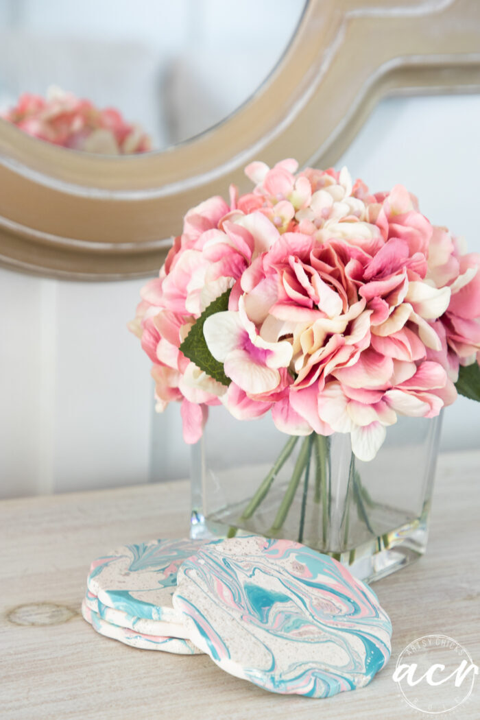 pink flowers on dresser with coasters
