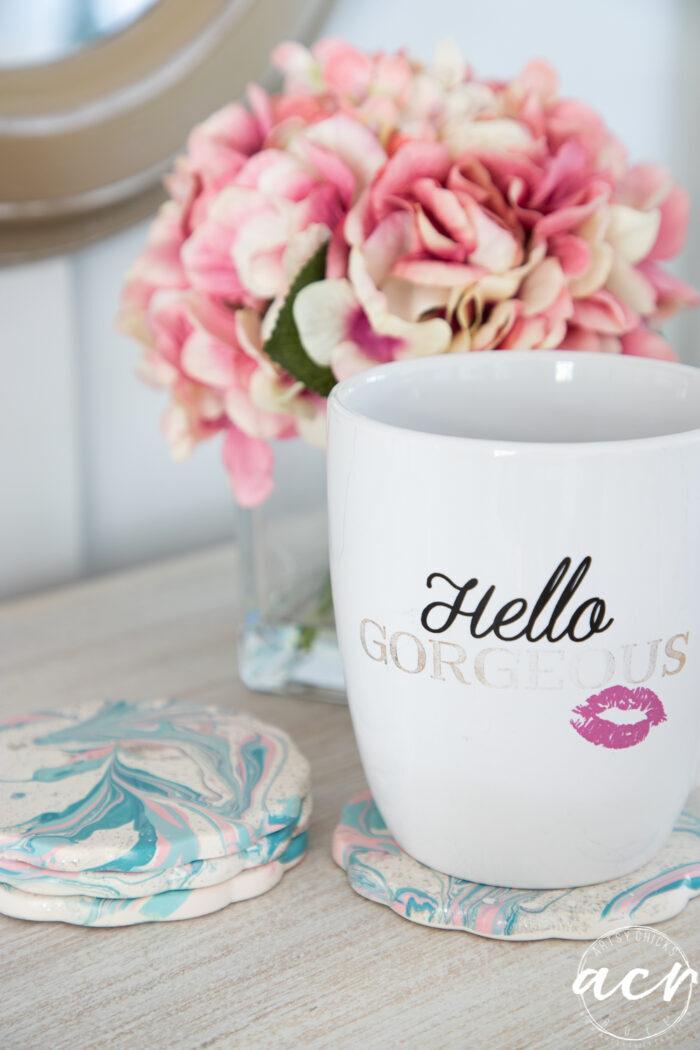 coffee mug on marbled coasters