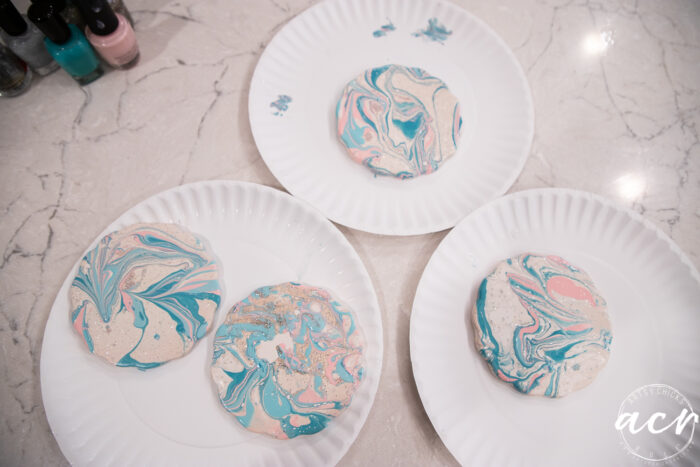 coasters marbled drying on paper plates