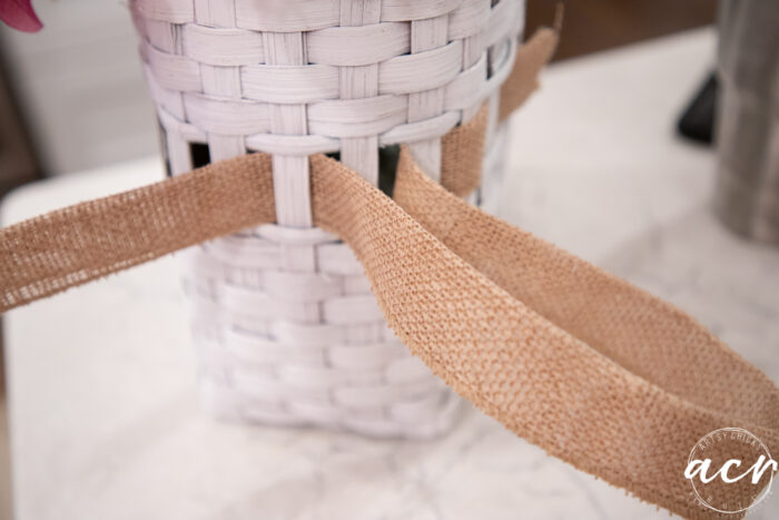 waving the ribbon into the basket