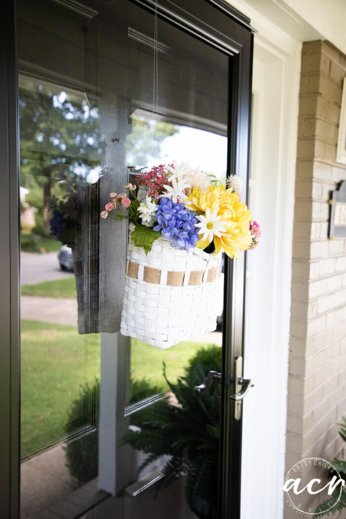 basket hanging on glass storm door