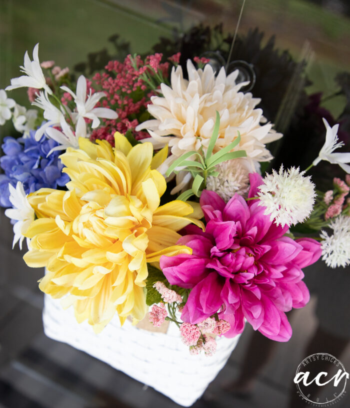 top view of basket with colorful flowers