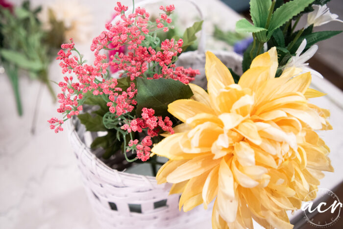 arranging the florals in the basket