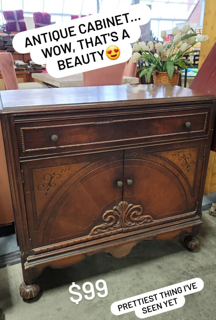 antique wood cabinet with doors and decorative trim