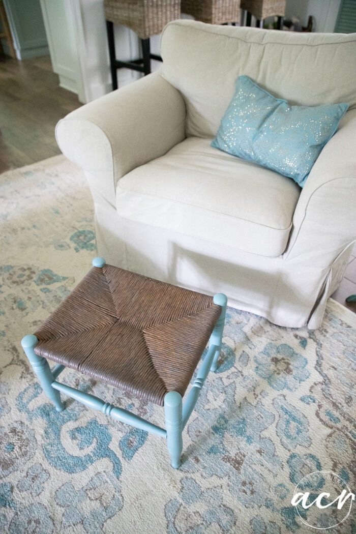 tan chair blue pillow and footstool