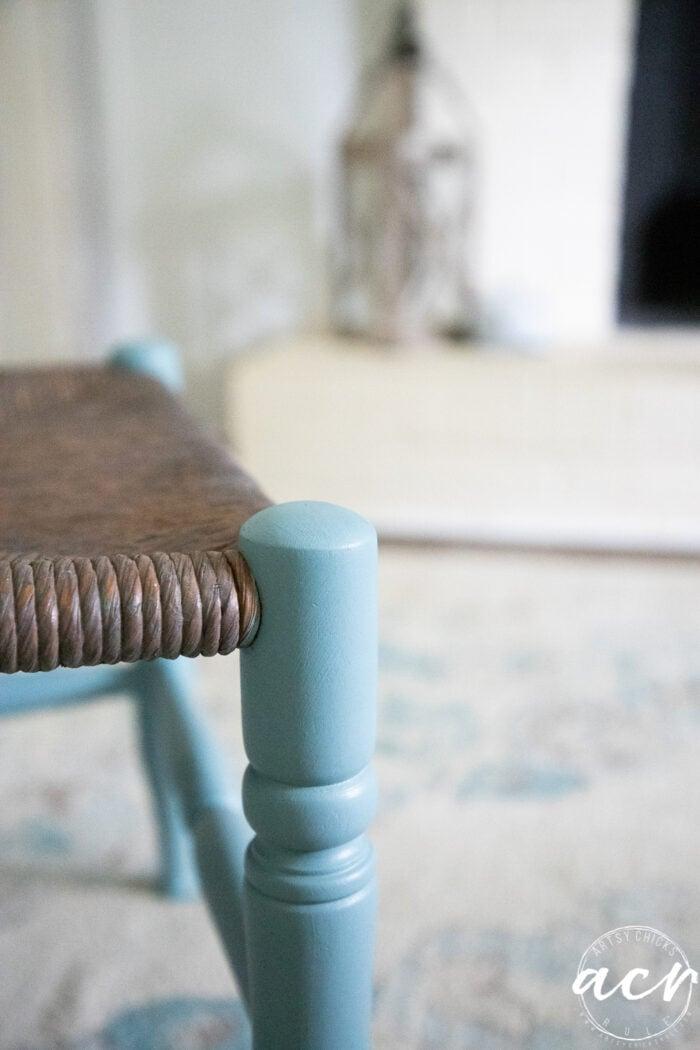up close of blue wood rush stool